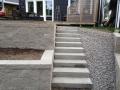 Vår samarbetspartner Nacka Schakt har byggt en trappa och en mur.